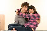 Education high school couple posing in corridor, boy holding girl
