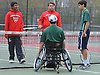 Nimesh Withanage, left, and Christian DeMarzo of Smithtown East prepare to compete against Nate Melnyk and Bobby Bellino, right, of Harborfields in a third doubles varsity boys tennis match at Smithtown High School East on Tuesday, Apr. 29, 2016. Melnyk, a wheelchair-using junior, played in his first varsity match, which was suspended in the first set due to the inclement weather. The match is set to resume on Monday, May 2.
