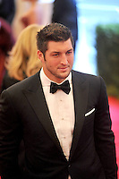Tim Tebow at the 'Schiaparelli And Prada: Impossible Conversations' Costume Institute Gala at the Metropolitan Museum of Art on May 7, 2012 in New York City. © mpi03/MediaPunch Inc.