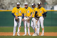(L-R) Nick Rogers #9, Mark Nales #2, Marquis Riley #23 and James Howard #15 of the North Carolina A&T Aggies huddle as a pitching change is being made at War Memorial Stadium March 23, 2010, in Greensboro, North Carolina.  Photo by Brian Westerholt / Four Seam Images