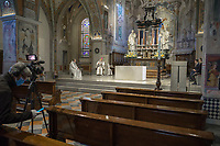 "Switzerland. Canton Ticino. Lugano. Easter in Cattedrale di San Lorenzo. The bishop Valerio Lazzeri celebrates the Sunday mass in an empty cathedral. The believers could not attend the religious service due to the coronavirus. A cameraman from the RSI is filming the service and it can be looked at on streaming on internet. Radiotelevisione svizzera di lingua italiana (RSI) is a Swiss public broadcasting organisation, part of SRG SSR.Valerio Lazzeri (born 22 July 1963) is a Swiss Roman Catholic bishop. Ordained to the priesthood on 2 September 1989, Lazzeri was named bishop of the Roman Catholic Diocese of Lugano, Switzerland on 4 November 2013. Easter, also called Pascha or Resurrection Sunday, is a festival and holiday commemorating the resurrection of Jesus from the dead, described in the New Testament as having occurred on the third day after his burial following his crucifixion by the Romans. The Diocese of Lugano is a branch of the Catholic Church immediately subject to the Holy See.  Due to the spread of the coronavirus (also called Covid-19), the Federal Council has categorised the situation in the country as ""extraordinary"". It has issued a recommendation to all citizens to stay at home, especially the sick and the elderly. From March 16 the government ramped up its response to the widening pandemic, ordering the closure of religious services. 12.04.2020  © 2020 Didier Ruef"