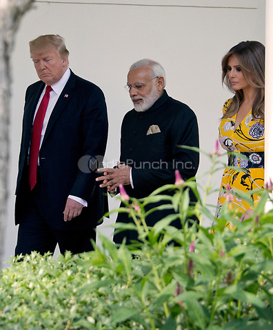 United States President Donald J. Trump and first lady Melania Trump walk on the Colonnade to the Oval Office with Prime Minister Narendra Modi of India at the White House in Washington, DC on Monday, June 26, 2017.<br /> Credit: Ron Sachs / CNP /MediaPunch