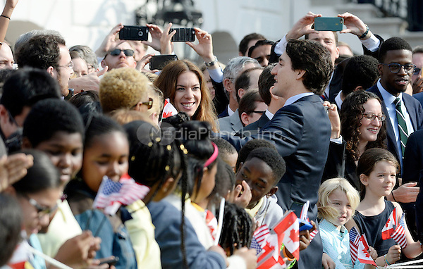 Prime Minister Justin Trudeau of Canada shakes hands with guests during an Official Arrival ceremony a the White House, March 10, 2016 in Washington, D.C.  <br /> Credit: Olivier Douliery / Pool via CNP/MediaPunch