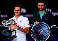 Roger Federer of Switzerland and Marion Cilic of Croatia pose with their trophies on Day 14 of the Australian Open