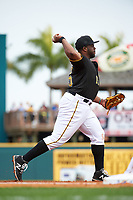 Pittsburgh Pirates third baseman Jason Rogers (15) throws to first during a Spring Training game against the Toronto Blue Jays  on March 3, 2016 at McKechnie Field in Bradenton, Florida.  Toronto defeated Pittsburgh 10-8.  (Mike Janes/Four Seam Images)