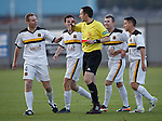 Referee Barry Cook surrounded by angry Dumbarton players after sending off Colin Nish