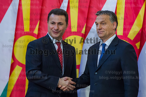 Nikola Gruevski (L) Prime Minister of Macedonia and his counterpart Viktor Orban (R) shake hands during a welcoming ceremony in Budapest, Hungary on November 14, 2012. ATTILA VOLGYI