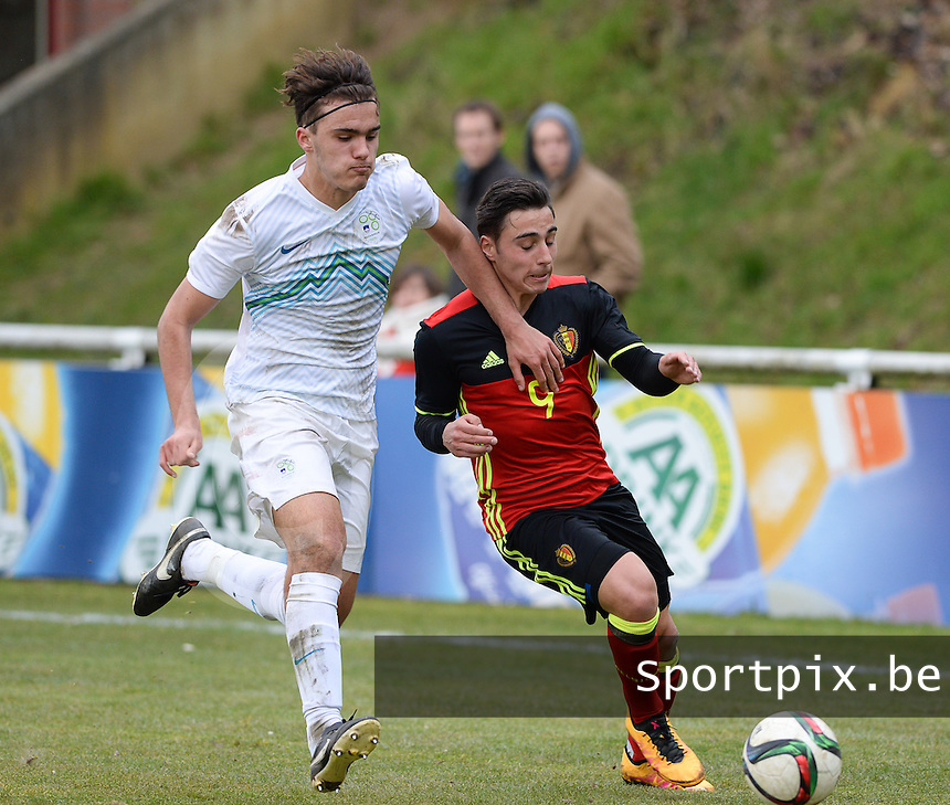 20160311 - Overijse , BELGIUM : Belgian Jules Vanhaecke (right) pictured in a duel with Slovenian Vanja Drkusic (left) during the soccer match between the under 17 teams of  Belgium and Slovenia , on the first matchday in group 8 of the UEFA Under17 Elite rounds at Begijnhofstadion in Overijse , Belgium. Friday 11th March 2016 . PHOTO DAVID CATRY
