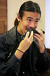 A man eats a &quot;kuro burger&quot; or &quot;black burgers&quot; at Burger King restaurant on September 19, 2014 in Tokyo, Japan. Burger King launches to its menu two kinds of black burgers &quot;Kuro Diamond&quot; and &quot;Kuro Pearl&quot; which contains black buns and black cheese made from bamboo charcoal, garlic sauce made with squid ink and beef patties made with black pepper all in black color starting on Friday, September 19 for a limit period. The Kuro Diamond priced at 690 JPY <br /> (6.35 USD) and the Kuro Pearl which cost at 480 JPY (4.42 USD). The last year Burger King included the &quot;Ninja Burger&quot; similar black burger on its Japanese menu. (Photo by Rodrigo Reyes Marin/AFLO)