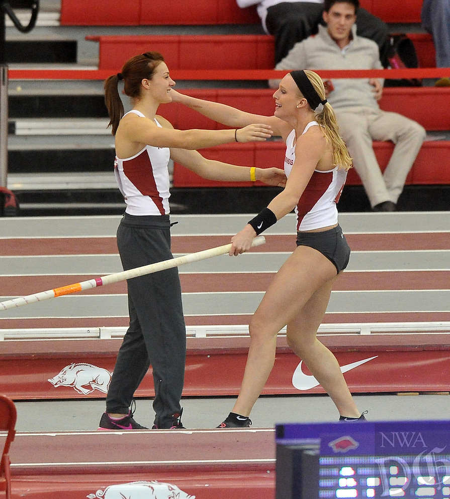 NWA Democrat-Gazette/Michael Woods --01/16/2015-- w @NWAMICHAELW... University of Arkansas pole vaulter Sandi Morris (right) gets a hug from teammate Ariel Voskamp after her final jump in the women's pole vault event Friday night during the Arkansas vs. Texas dual track meet at the Randal Tyson Track Center in Fayetteville.