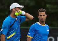 Netherlands, Den Bosch, 16.06.2014. Tennis, Topshelf Open, Jean-Julien Rojer (NED) with his doubles partner Horia Tecau (ROU) (L)<br /> Photo:Tennisimages/Henk Koster
