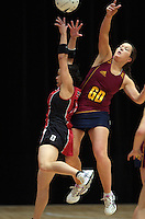05.10.2012 Southland's Kendall McMinn and Counties Manukau's Ruth Hei Hei in action during the netball match between Southland and Counties Manukau at the Lion Foundation Netball Champs in Tauranga. Mandatory Photo Credit ©Michael Bradley.