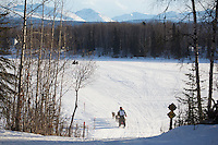 Second-place finisher, Andrew Nolan, runs on the inbound trail towards the finish line of the 2016 Junior Iditarod in Willow, Alaska, AK  February 28, 2016