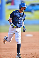 Asheville Tourists center fielder Manny Melendez (19) rounds the bases during a game against the Lakewood BlueClaws at McCormick Field on June 3, 2017 in Asheville, North Carolina. The Tourists defeated the BlueClaws 10-7. (Tony Farlow/Four Seam Images)