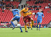 Murray Davidson and John Sutton challenging for the ball