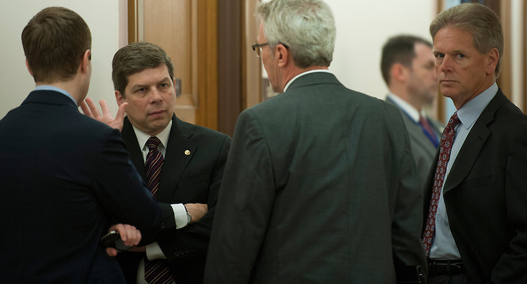 UNITED STATES - April 17: Sen. Mark Begich, D-AK., talks with staff out side of the full committee hearing on the Homeland Security Department's budget submission for FY2014. (Photo By Douglas Graham/CQ Roll Call)