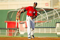 Kannapolis Intimidators first baseman Keon Barnum (35) throws the ball around the infield between innings of the South Atlantic League game against the West Virginia Power at CMC-Northeast Stadium on July 9, 2013 in Kannapolis, North Carolina.  The Power defeated the Intimidators 3-1.   (Brian Westerholt/Four Seam Images)