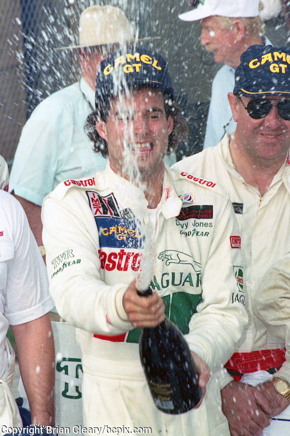 Davy Jones sprays champagne in Victory Lane after winning the SunBank 24 at Daytona at Daytona International Speedway, Daytona Beach, FL,February 3-4, 1990.  (Photo by Brian Cleary/www.bcpix.com)