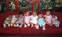 Baby girls that have been adopted by overseas people are lined -up for a photograph before they leave China.  Only baby girls are allowed for adoption since all China's orphanages are swamped with baby girls who are often dumped at birth since parents would prefer their only child to be a boy.  Boys greatly out number girls in China.<br /> ©sinopix