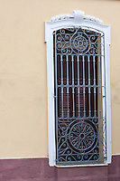 Cuba, Cienfuegos.  Wrought-iron Window Grille.