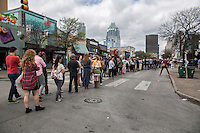 SXSW patrons form long lines on 6th street to see new and undiscovered bands from all over the world looking for exposure.