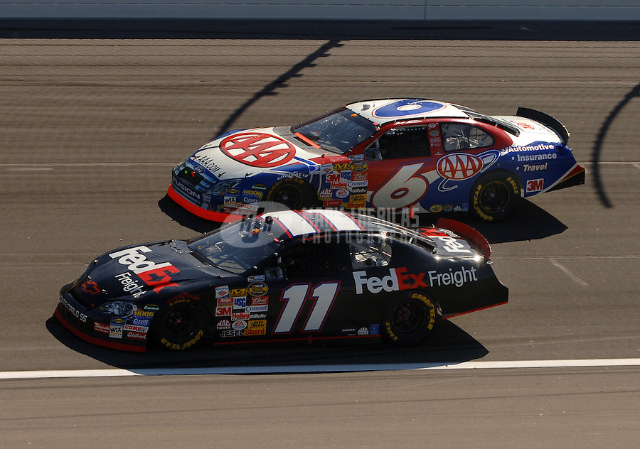 Oct 1, 2006; Kansas City, KS, USA; Nascar Nextel Cup driver Denny Hamlin (11) leads Mark Martin (6) during the Banquet 400 at Kansas Speedway. Mandatory Credit: Mark J. Rebilas