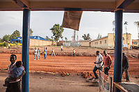 """This is the old commercial quarter of Butare. It was made by Arabs in the 1920s so sometimes its called the Arab quarter. The authorities are destroying all the buildings and not paying attention. I walked down these streets everyday for five years.  I saw these shops every day. I bought clothes and food here. I really understood these buildings. Intimately. Now they are being lost and replaced with multi-story buildings."" Yves Manzi, artist. Butare, Rwanda. Photo by Brendan Bannon. Feb 27, 2014."