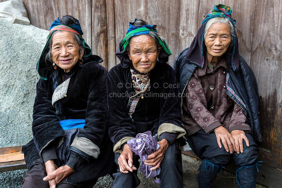 Huanggang, Guizhou, China.  Elderly Dong Women in a Dong Ethnic Village.