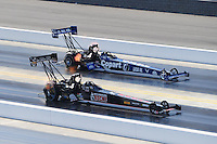Sept. 18, 2010; Concord, NC, USA; NHRA top fuel dragster driver Doug Kalitta (near) races alongside Brandon Bernstein during qualifying for the O'Reilly Auto Parts NHRA Nationals at zMax Dragway. Mandatory Credit: Mark J. Rebilas /