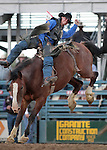 Orin Larsen competes in the bareback bronc riding event at the Reno Rodeo, in Reno, Nev. on Friday night, June 22, 2012..Photo by Cathleen Allison
