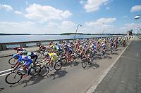 peloton over the wier next to the lake<br /> <br /> 2014 Belgium Tour<br /> stage 4: Lacs de l'Eau d'Heure - Lacs de l'Eau d'Heure (178km)