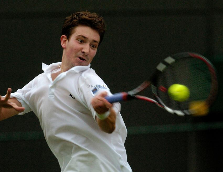 Photo: Richard Lane..Wimbledon Championships. 27/06/2006. .Great Britain's Alex Bogdanovic returns during his 1st round match.
