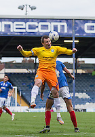 Garry Thompson of Wycombe Wanderers wins the ball during the Sky Bet League 2 match between Portsmouth and Wycombe Wanderers at Fratton Park, Portsmouth, England on 23 April 2016. Photo by Andy Rowland.