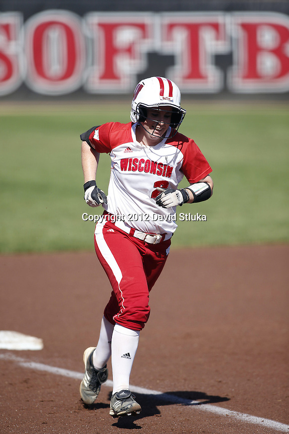 Wisconsin Badgers Whitney Massey (2) celebrates a home run during an NCAA women's softball game against the Green Bay Phoenix Saturday, September 29, 2012 in Madison, Wis. (Photo by David Stluka)