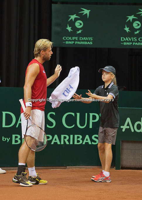 14-sept.-2013,Netherlands, Groningen,  Martini Plaza, Tennis, DavisCup Netherlands-Austria, Doubles,   Oliver Marach throws a towel to a ballgirl<br /> Photo: Henk Koster