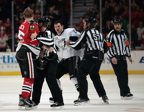 13 December 2009:The Tampa Bay Lightning's C, Zenon Konopka (28) has words for Cam Barker as they head to the penalty box during their 4-0 loss to the Chicago Blackhawks at the United Center in Chicago, Illinois. Photo by Chuck Rydlewski/Actionplus. UK Licenses Only