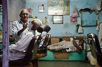 GUJARAT: A shave and a nap in Rajkot. Photo by Michael Benanav.