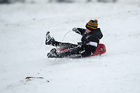 Pictured: A young boys sledge in the snow at Libanus, in Brecon, Wales, UK. Friday 01 February 2019<br /> Re: Heavy snow and freezing temperatures affecting parts of the UK.