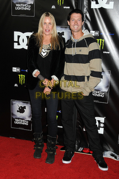 "Daryl Hannah, Danny Way.""Waiting For Lightning"" Los Angeles Screening held at The Cinerama Dome, Hollywood, California, USA..April 10th, 2012.full length top beige black striped stripes jeans denim.CAP/ADM/BP.©Byron Purvis/AdMedia/Capital Pictures."