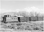 Caboose and stock cars at Gunnison.<br /> D&amp;RGW  Gunnison, CO  Taken by Richardson, Robert W. - 10/3/1952