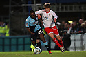 Luke Freeman of Stevenage (on loan from Arsenal) and Anthony McNamee of Wycombe challenge. - Wycombe Wanderers v Stevenage - Adams Park, High Wycombe - 31st December 2011  .© Kevin Coleman 2011