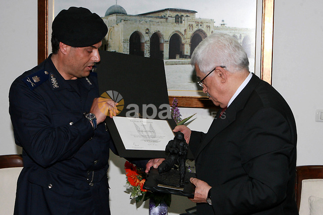 Palestinian President, Mahmoud Abbas (Abu Mazen) meets with a delegation from the Palestinian police in the West Bank City of Ramallah, on May 15, 2012.  Photo by Thaer Ganaim
