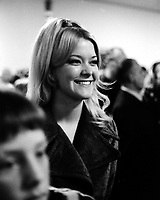 Mrs. Gary Smith, wife of Seals goalie in crowd at Seals hockey game in Oakland. 1970. (photo/Ron Riesterer)