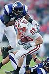 November 21, 2009: Northwestern Wildcats linebacker Quentin Davie (41) tackles Wisconsin Badgers tight end Garrett Graham (89) during an NCAA football game at  Ryan Field on November 21, 2009 in Evanston, Illinois. The Wildcats won 33-31. (Photo by David Stluka)
