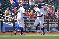 Carlos Peguero #39 of the Omaha Storm Chasers get handshake from third base coach after hitting a home run against the Las Vegas 51s at Werner Park on August 17, 2014 in Omaha, Nebraska. The Storm Chasers  won 4-0.   (Dennis Hubbard/Four Seam Images)