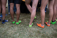 Mud is seen on the legs of Colorado runners as they speak to media after winning the national title during the NCAA Cross Country Championships in Terre Haute, Ind. on Saturday, Nov. 22, 2014. (James Brosher, Special to the Denver Post)
