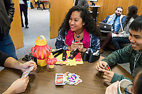 Karonika Brown, 34, (second from right) plays UNO before a Lunar New Year celebration in the Asian American Connections Center at Middlesex Community College in Lowell, Mass., USA, on Thurs., Feb. 15, 2018. Brown graduated with a degree with an Associates Degree in Liberal Arts and Sciences from Middlesex Community College in 2016, and continues to take classes there and work as a writing tutor for other students. Brown is an immigrant from Cambodia. The Asian American Connections Center was established at the school using a federal grant in 2016 and serves as a focal point for the Asian community at the school, predominantly Cambodian, to gather, socialize, study, and otherwise take part in student life.