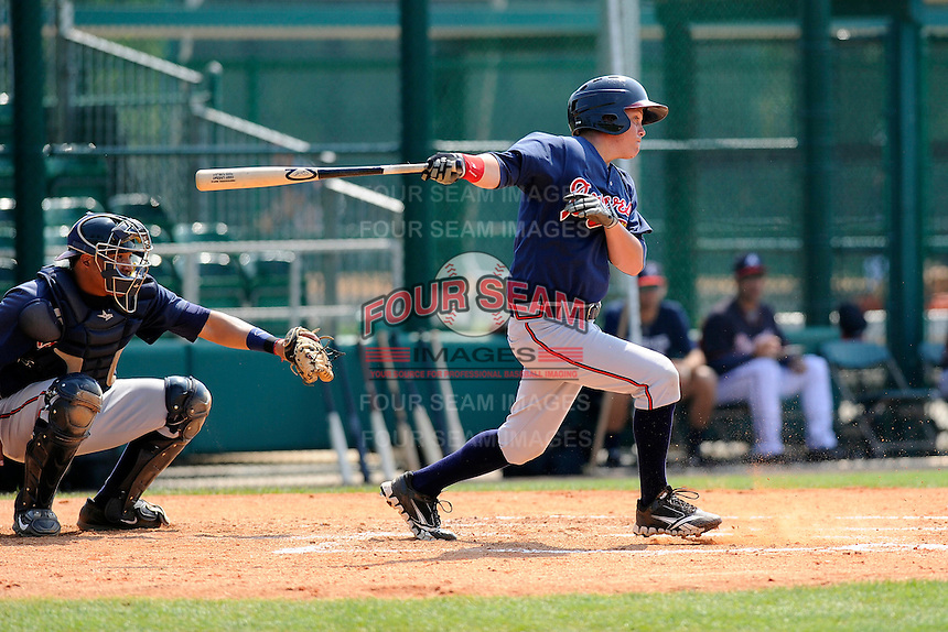 Outfielder Cody Livesay (9) of the Atlanta Braves farm system in a Minor League Spring Training intrasquad game on Wednesday, March 18, 2015, at the ESPN Wide World of Sports Complex in Lake Buena Vista, Florida. The catcher is Carlos Martinez. (Tom Priddy/Four Seam Images)