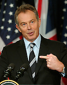 Washington, D.C. - December , 2006 -- Prime Minister Tony Blair of Great Britain responds to a reporter's question during a joint press conference with United States President George W. Bush at the White House in Washington, D.C. on Thursday, December 7, 2006..Credit: Ron Sachs / CNP