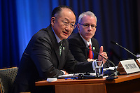 Washington, DC - April 14, 2016: Jim Yong Kim, President of the World Bank Group, speaks to members of the media during a press availability at the IMF headquarters in the District of Columbia, April 14, 2016, as communications advisor John Donnelly (r) looks on.  (Photo by Don Baxter/Media Images International)